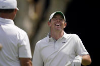 Rory McIlroy, of Northern Ireland, right, laughs with Paul Casey, of England, during a practice round of the U.S. Open Golf Championship, Tuesday, June 15, 2021, at Torrey Pines Golf Course in San Diego. (AP Photo/Gregory Bull)