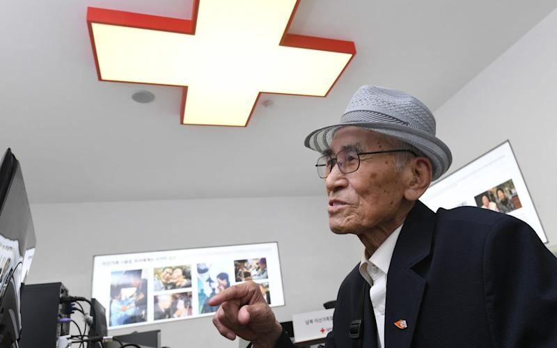 An elderly South Korean man visits the Red Cross office in Seoul to fill out applications for an inter-Korean family reunion programme - AFP