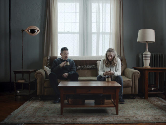 Ethan Hawke, left, and Amanda Seyfried in a scene from <em>First Reformed</em>. (Photo: A24 via AP)