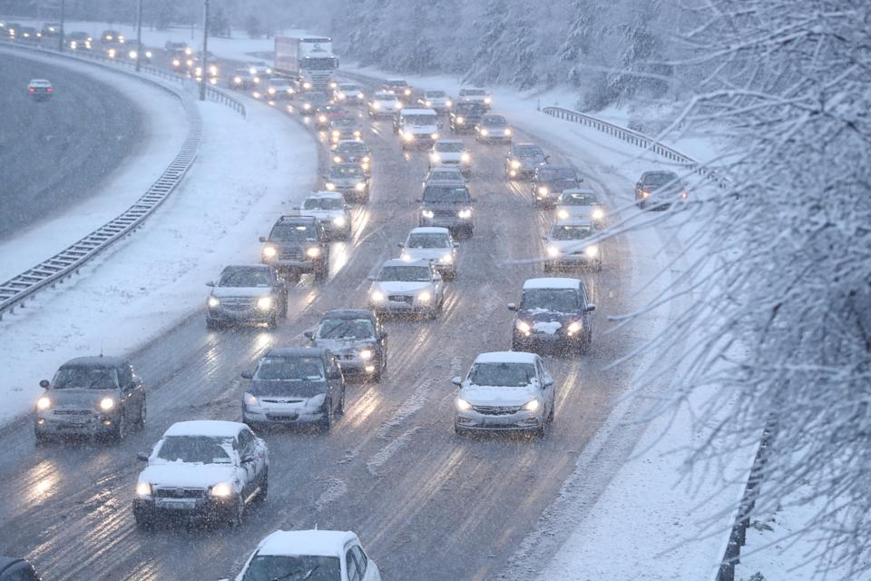 Traffic in snowy conditions on the N7 in Dublin. Snow and sleet has caused travel disruption in Ireland as Storm Freya causes travel disruption amid a number of weather warnings.