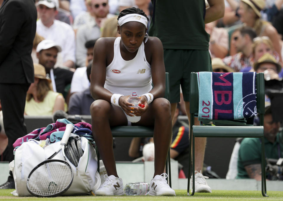 "United States' Cori ""Coco"" Gauff is dejected after losing to Romania's Simona Halep in a women's singles match against on day seven of the Wimbledon Tennis Championships in London, Monday, July 8, 2019. (AP Photo/Kirsty Wigglesworth)"