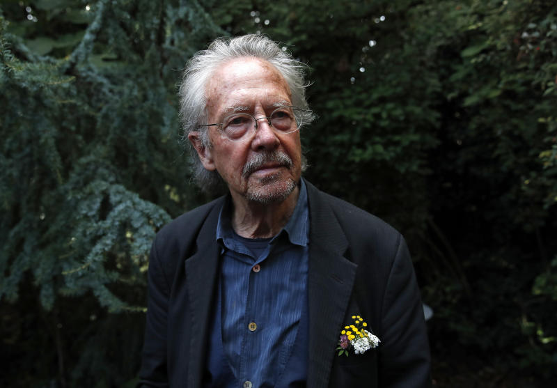 FILE - In this Thursday, Oct. 10, 2019 file photo, Austrian author Peter Handke poses for a photo at his house in Chaville near Paris. Several dozen survivors of Bosnia's 1992-95 war staged a protest in Sarajevo to call on the Nobel Committee to reverse its decision to award the 2019 Nobel Prize in literature to Austria's Peter Handke. Protesters gathered outside the Swedish embassy in downtown Sarajevo Tuesday carrying banners with slogans comparing Handke with Serbian strongman Slobodan Milosevic and Bosnian Serb war-time leaders Radovan Karadzic and Ratko Mladic. (AP Photo/Francois Mori, file)