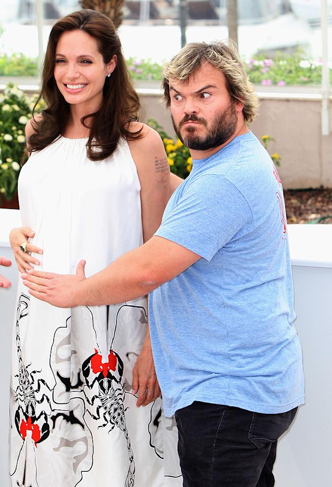 "CANNES, FRANCE - MAY 15:  (UK Tabloid  Papers Out)  Actors Angelina Jolie and Jack Black attend the photocall for ""Kung Fu Panda"" during the Cannes International Film Festival on May 15, 2008 in Cannes, France.  (Photo by Dave Hogan/Getty Images)"