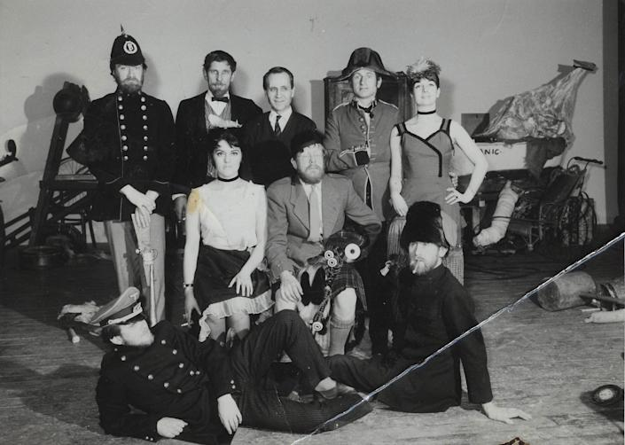 Douglas Gray (seated, with bagpipes) and fellow cast members of An Evening of British Rubbish