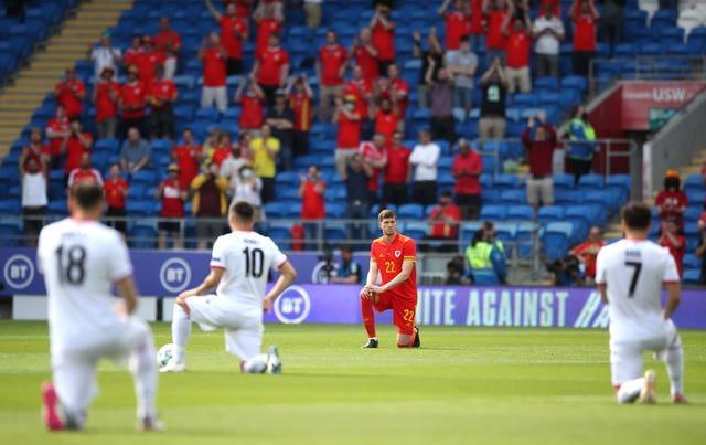 Wales and Albania players take the knee prior to kick-off