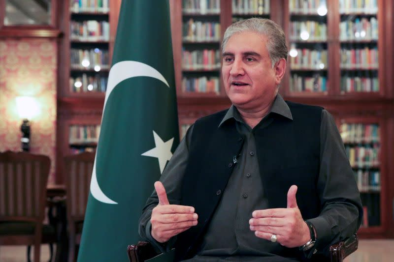 FILE PHOTO: Pakistani Foreign Minister Shah Mehmood Qureshi gestures while speaking during an interview with Reuters at the Ministry of Foreign Affairs in Islamabad