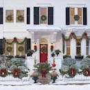 <p>This grand front porch is completely decked out for the holidays. From the garland to the berry-filled wreaths in every window your outdoor Christmas decorations can't get more stunning than this. </p>