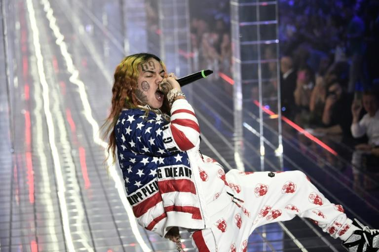 US rapper Tekashi 6ix9ine -- seen performing in Milan in September 2018 -- was sentenced to two years in federal prison on gun, drug and racketeering charges