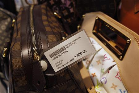 A second-hand Louis Vuitton handbag is displayed with a price-tag of HK$9,900 ($1,269) from its original price of HK$15,200 (US$1,949) at a Milan Station outlet in Hong Kong September 2, 2013. REUTERS/Bobby Yip