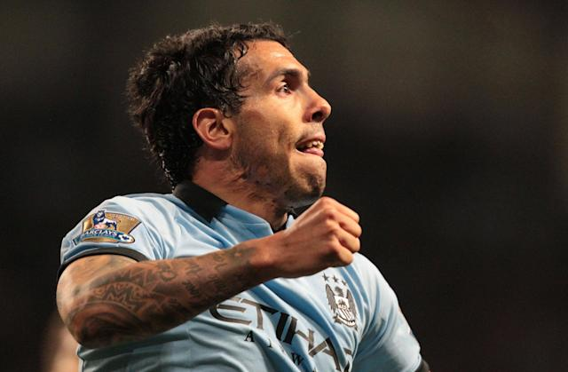 "Manchester City's Argentinian striker Carlos Tevez celebrates scoring the opening goal of the English Premier League football match between Manchester City and Wigan Athletic at the Etihad Stadium in Manchester, northwest England, on April 17, 2013. AFP PHOTO/LINDSEY PARNABY "" RESTRICTED TO EDITORIAL USE. No use with unauthorized audio, video, data, fixture lists, club/league logos or ""live"" services. Online in-match use limited to 45 images, no video emulation. No use in betting, games or single club/league/player publications. ""LINDSEY PARNABY/AFP/Getty Images"