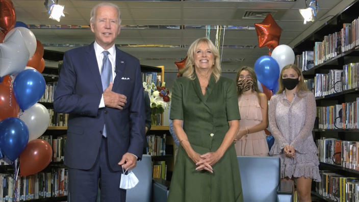 In this image from video, Democratic presidential candidate former Vice President Joe Biden, his wife Jill Biden, and members of the Biden family, celebrate after the roll call during the second night of the Democratic National Convention on Tuesday, Aug. 18, 2020. (Democratic National Convention via AP)