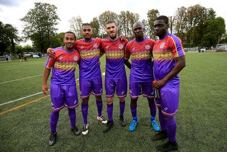 Clapton CFC players pose for pictures after their away game win 2-1 against Ealing Town in East Acton, in London, Britain September 15, 2018. REUTERS/James Akena