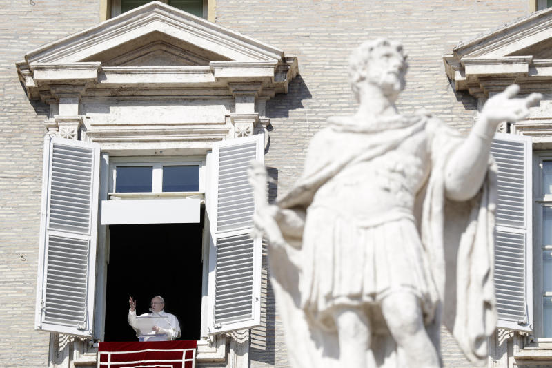 """Pope Francis delivers his blessing during the Angelus noon prayer In St. Peter's Square at the Vatican, Sunday, Feb. 17, 2019. The pontiff is asking for prayers for this week's sex abuse summit at the Vatican, calling abuse an """"urgent challenge of our time."""" (AP Photo/Gregorio Borgia)"""