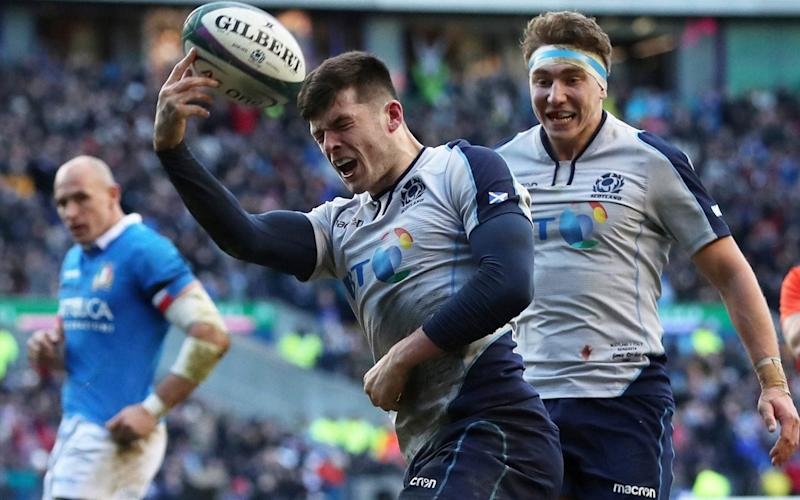Blair Kinghorn celebrates scoring Scotland's fourth try to complete his hat-trick - ACTION IMAGES