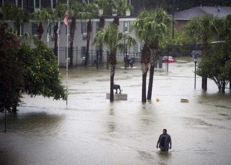 A resident wades through floodwater at Tiger Manor Apartments, by the North Gate of LSU. (Photo: Brianna Paciorka/The Advocate via AP)