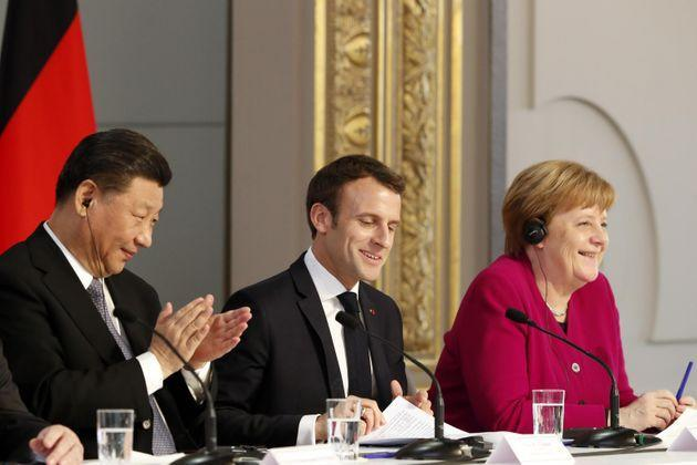 epa07464284 French President Emmanuel Macron, (C), Chinese President Xi Jinping (L) and German Chancellor Angela Merkel (R) hold a press conference at the Elysee presidential palace in Paris, France, 26 March 2019. Xi Jinping is meeting with the leaders of France, Germany and the European Commission, as European countries seek to boost relations with China while also putting pressure over its trade practices.  EPA/Thibault Camus / POOL  MAXPPP OUT (Photo: Thibault CamusEPA)