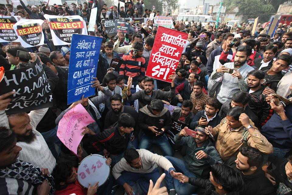 Protesters shout slogens with placards during a demonstration against India's new citizenship law CAA ( Citizenship amandment Act ) in Allahabad on December 19,2019 . Indians defied bans nationwide as anger swells against a citizenship law seen as discriminatory against muslims, following days of protest, clashes, and riots that have left six dead .(Photo by Ritesh Shukla/NurPhoto via Getty Images)