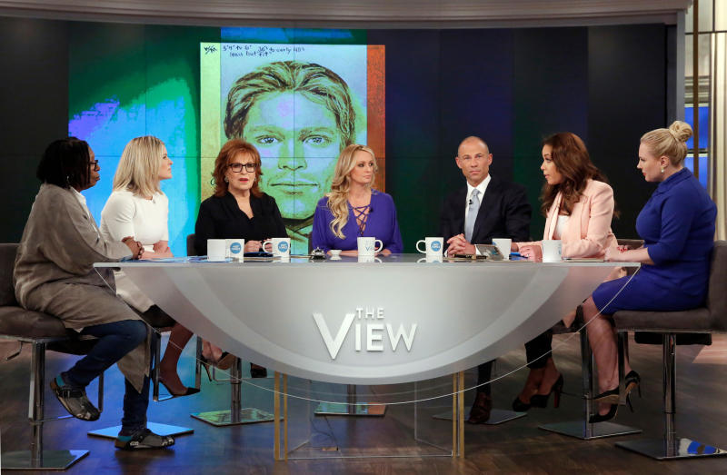 Does the sketch of a man who allegedly threatened Stormy Daniels look like Tom Brady? Twitter thinks so. This image released by ABC shows, from left, co-hosts Whoopi Goldberg, Sara Haines, Joy Behar, adult film actress Stormy Daniels, her attorney Michael Avenatti, co-hosts Sunny Hostin and Meghan McCain during an appearance on the daytime talk show