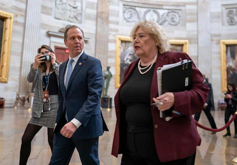 House Intelligence Committee Chairman Adam Schiff, D-Calif., and Rep. Zoe Lofgren, D-Calif., right, walk through the Capitol Rotunda during the impeachment trial of President Donald Trump on Friday.