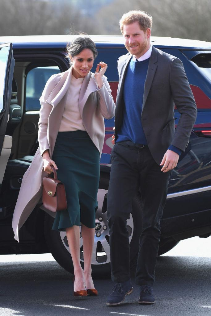 """<p><strong>When: March 23, 2018</strong><br>Meghan Markle and her fiancé Prince Harry made a surprise visit to Northern Ireland on Friday — their first official joint visit to the country — and Markle stunned in a cream cashmere sweater by Victoria Beckham (coyly <a rel=""""nofollow"""" href=""""https://ca.style.yahoo.com/lifestyle/meghan-markle-prince-harrys-beautiful-engagement-photos-show-love-135453506.html"""" data-ylk=""""slk:recycled;outcm:mb_qualified_link;_E:mb_qualified_link;ct:story;"""" class=""""link rapid-noclick-resp yahoo-link"""">recycled</a> from her engagement photos). <em>(Photo: Getty)</em> </p>"""
