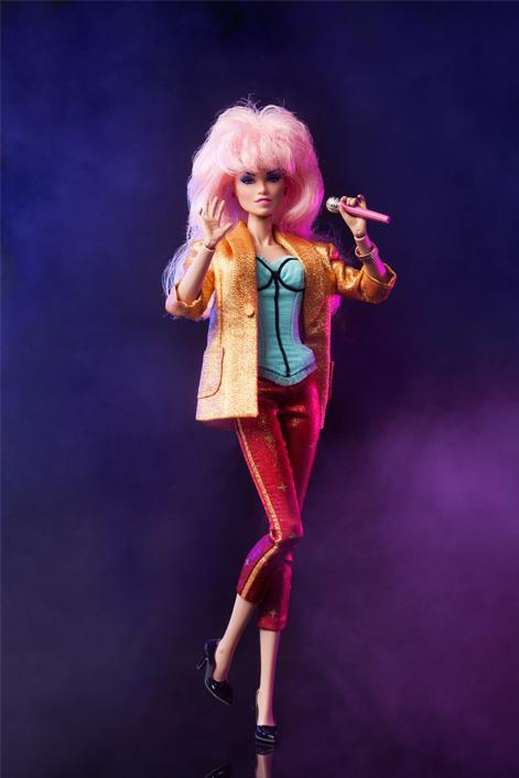 """<div class=""""caption-credit"""">Photo by: Hasbro/Integrity Toys</div><b>New Hollywood Jem</b> <br> We love this adaptation featuring all the little details like tuxedo stripes on the pants, a corset top, black pumps, and of course, the JemStar earrings."""