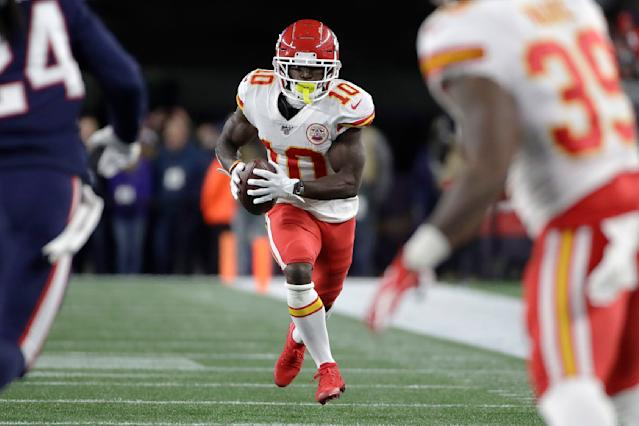 Kansas City Chiefs wide receiver Tyreek Hill, center, carries the ball in the first half of an NFL football game against the New England Patriots, Sunday, Dec. 8, 2019, in Foxborough, Mass. (AP Photo/Elise Amendola)