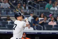 New York Yankees' Giancarlo Stanton watches his three-run home run during the fourth inning of the team's baseball game against the Baltimore Orioles, Tuesday, Aug. 3, 2021, in New York. (AP Photo/Mary Altaffer)