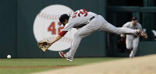 St. Louis Cardinals shortstop Pete Kozma can't get a ball by Washington Nationals' Ian Desmond during the first inning of a baseball game at Nationals Park Friday, Aug. 31, 2012, in Washington. (AP Photo/Alex Brandon)