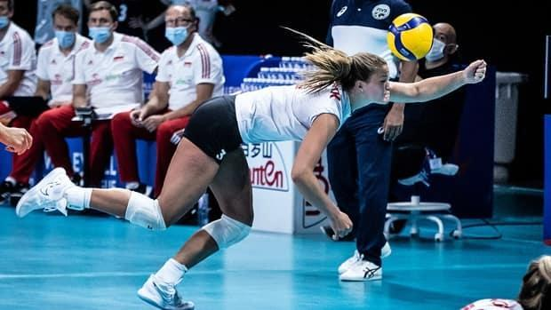 Opposite hitter Kiera van Ryk attempts to keep a rally live for Canada in Volleyball Nations League play against Poland on Sunday in Rimini, Italy. The Canadians took the first two sets before losing three in a row and seeing their record slip to 2-5. (Submitted by volleyballworld.com - image credit)