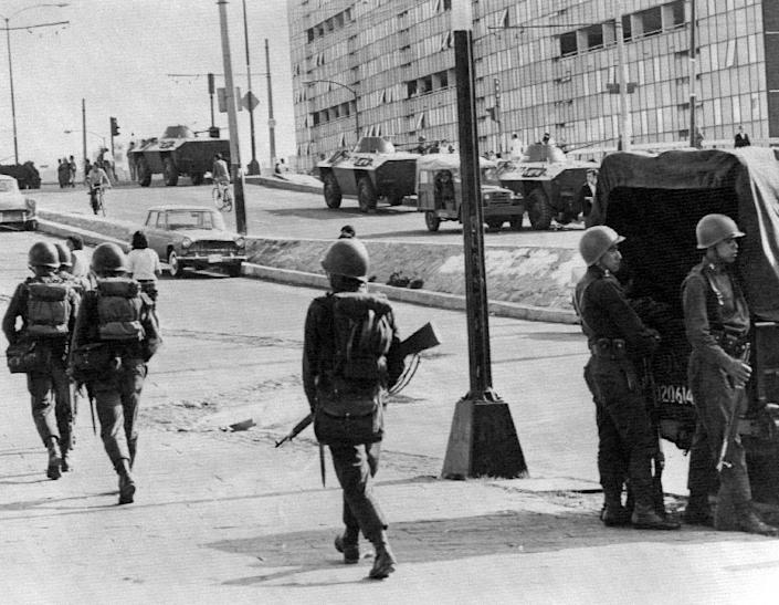 Soldiers on patrol in Mexico City in October 1968, three days after the army killed hundreds of protesters in an event known as the Tlatelolco Massacre just ahead of the Summer Olympics in the Mexican capital (AFP Photo/-)