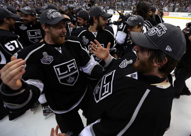 LOS ANGELES, CA - JUNE 11:  Trevor Lewis #22 (L) and goaltender Jonathan Quick #32 of the Los Angeles Kings celebrate after the Kings defeated the New Jersey Devils 6-1 to win the Stanley Cup series 4-2 in Game Six of the 2012 Stanley Cup Final at Staples Center on June 11, 2012 in Los Angeles, California.  (Photo by Bruce Bennett/Getty Images)