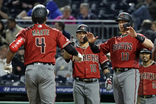 Arizona Diamondbacks' Ketel Marte (4) is greeted by Nick Ahmed (13) and Ildemaro Vargas (15) who were on base for his three-run home run off Pittsburgh Pirates relief pitcher Steven Brault in the eighth inning of a baseball game in Pittsburgh, Wednesday, April 24, 2019. It was Marte's second home run of the game. (AP Photo/Gene J. Puskar)