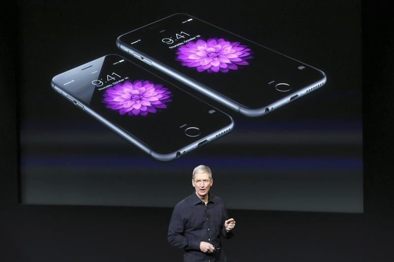 Apple CEO Tim Cook stands in front of a screen displaying the IPhone 6 during a presentation at Apple headquarters in Cupertino