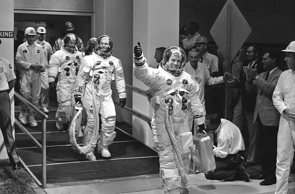Apollo 11 astronauts Neil Armstrong, Michael Collins and Edwin Aldrin Jr. appeared in a cheerful mood as they left the Manned Spacecraft Operations Building to enter the transfer van that takes them to Pad 39 where they will enter their spacecraft looking forward to a moon landing, July 16, 1969, Cape Kennedy, Fla. (AP Photo)