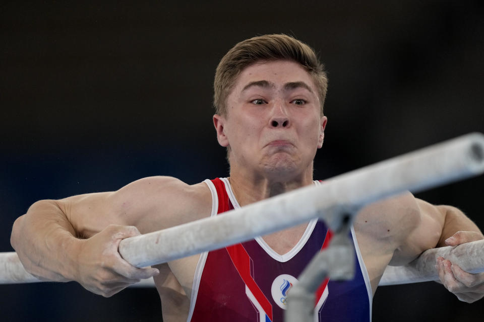 The Russian Olympic Committee's Aleksandr Kartsev performs on the parallel bars during the men's artistic gymnastic qualifications at the 2020 Summer Olympics, Saturday, July 24, 2021, in Tokyo. (AP Photo/Natacha Pisarenko)