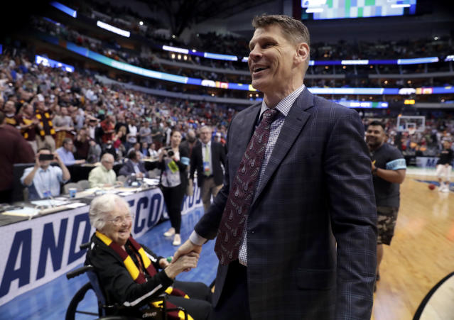 Sister Jean Dolores Schmidt, left, greets Loyola-Chicago coach Porter Moser after the team's 63-62 win over Tennessee in a second-round game at the NCAA men's college basketball tournament in Dallas, Saturday, March 17, 2018. (AP Photo/Tony Gutierrez)