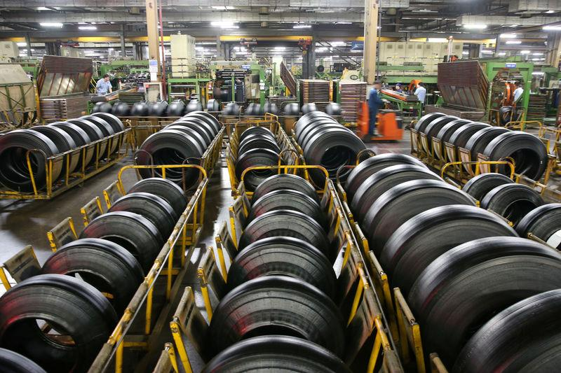 Workers are seen at a production line manufacturing tyres at a factory in Nantong, Jiangsu
