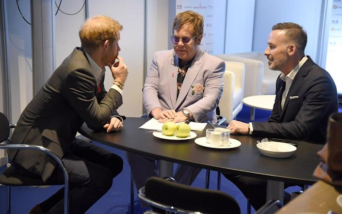 Prince Harry, Duke of Sussex, Sir Elton John, and David Furnish attend the Launch of the Menstar Coalition To Promote HIV Testing & Tre - Getty Images Europe