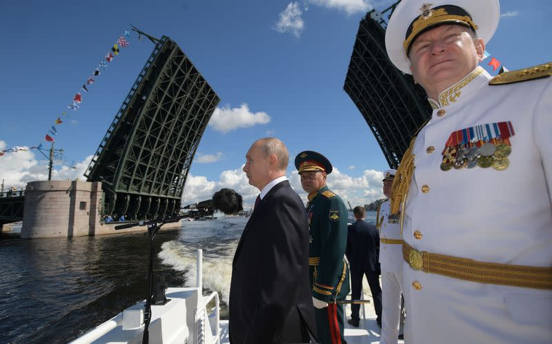 Putin Attends Naval Parade, Promises New Ships, Weapons