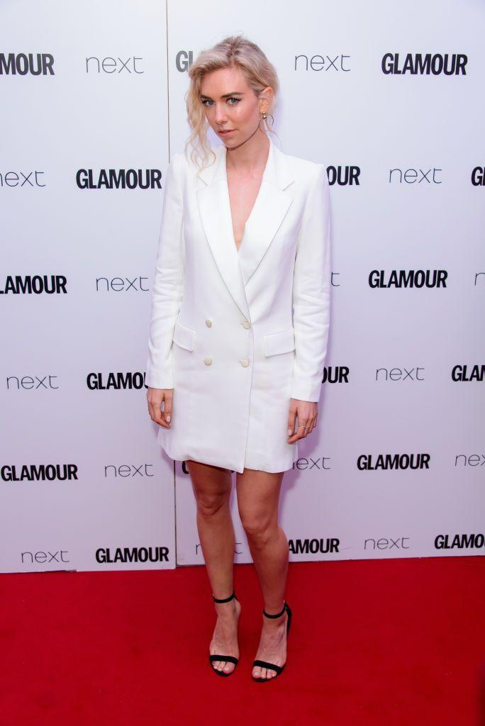 <p>Vanessa Kirby wore revealing white suit dress with elegant black ankle strap heels.</p>