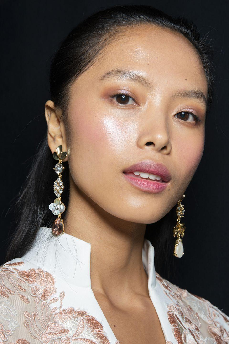 <p>Super-glossy skin with a sheer wash of fresh pink color on the eyes, lips, and cheeks backstage at Badgley Mischka.</p>