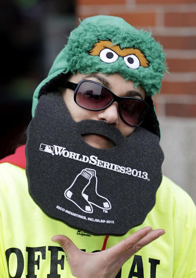Shavon Rodriguez shows off her foam beard before Game 1 of baseball's World Series between the Boston Red Sox and the St. Louis Cardinals Wednesday, Oct. 23, 2013, in Boston. Many of the Red Sox players have grown beards this season. (AP Photo/David J. Phillip)