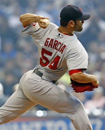 St. Louis Cardinals starting pitcher Jamie Garcia delivers during the second inning of an opening day baseball game against the Milwaukee Brewers, Friday, April 6, 2012, in Milwaukee. (AP Photo/Jeffrey Phelps)