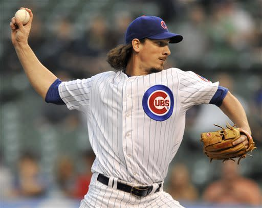 Chicago Cubs starter Jeff Samardzija delivers during the first inning of a baseball game against the Colorado Rockies in Chicago, Wednesday, May 15, 2013. (AP Photo/Paul Beaty)