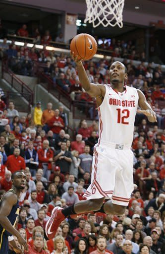 Ohio State's Sam Thompson (12) scores after a steal against Michigan during the first half of an NCAA college basketball game Sunday, Jan. 13, 2013 in Columbus, Ohio. Ohio State won 56-53. (AP Photo/Mike Munden)