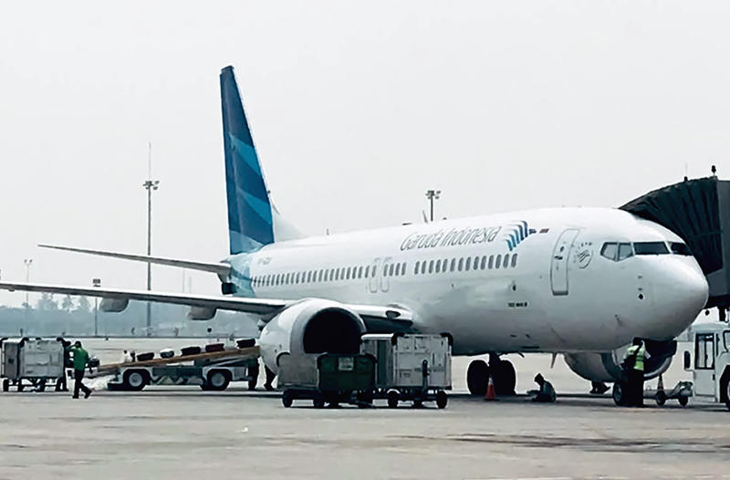 This picture taken on May 15, 2018 shows a Garuda Indonesia Boeing 737 Max 8 at Jakarta International airport in Jakarta. - Indonesia's national carrier Garuda will call off a multi-billion-dollar order for 49 Boeing 737 Max 8 jets after two fatal crashes involving the plane, the company said, in what is thought to be the first formal cancellation for the model. (Photo by IHWAN IDAMIN HARAHAP / AFP)        (Photo credit should read IHWAN IDAMIN HARAHAP/AFP/Getty Images)