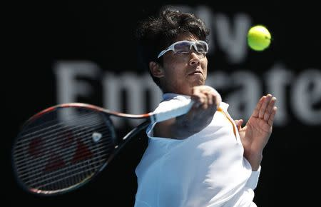 Tennis - Australian Open - Quarterfinals - Rod Laver Arena, Melbourne, Australia, January 24, 2018. Chung Hyeon of South Korea hits a shot against Tennys Sandgren of the U.S. REUTERS/Issei Kato