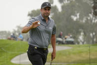 Richard Bland, of England, acknowledges the gallery after making his birdie putt on the second green during the second round of the U.S. Open Golf Championship, Friday, June 18, 2021, at Torrey Pines Golf Course in San Diego. (AP Photo/Marcio Jose Sanchez)