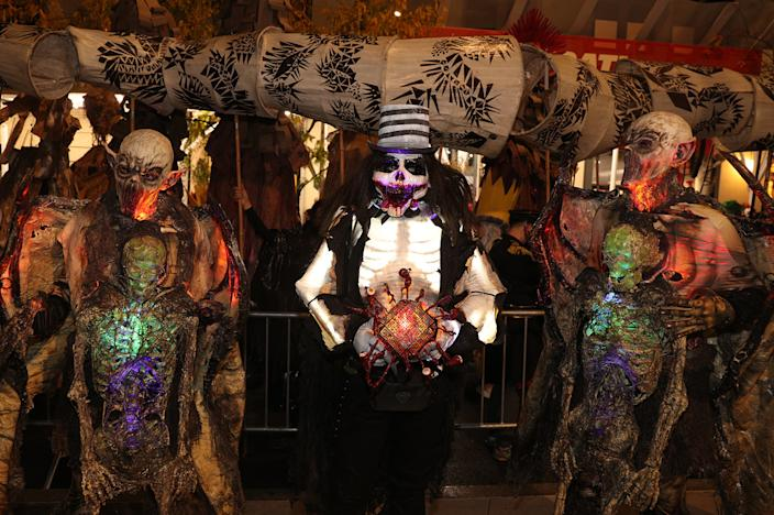 People wearing horror costumes participate in the Village Halloween Parade in New York City. (Photo: Gordon Donovan/Yahoo News)
