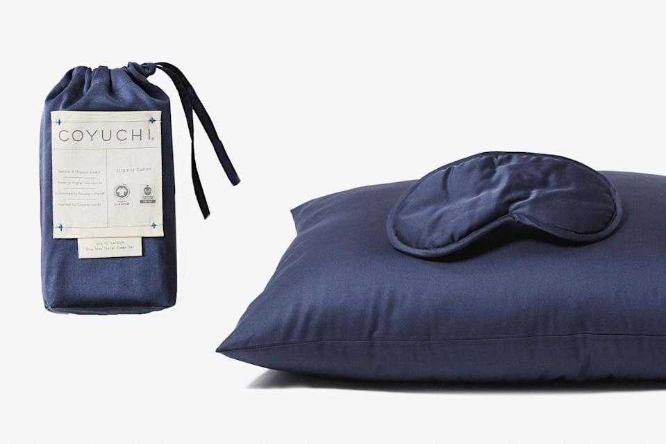 """For those who always prefer their own bed (and bedding), this wrinkle-averse organic cotton pillow and eye mask set has you covered. Pro tip: Opt for navy or gray so the sheets don't get lost—and woefully left behind—in hotel or Airbnb bedding. $34, Coyuchi. <a href=""""https://www.coyuchi.com/organic-sateen-travel-sleep-set.html"""" rel=""""nofollow noopener"""" target=""""_blank"""" data-ylk=""""slk:Get it now!"""" class=""""link rapid-noclick-resp"""">Get it now!</a>"""